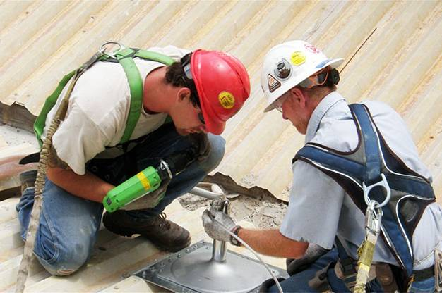 D. C. Taylor Co. contractors installing permanent fall protection system.