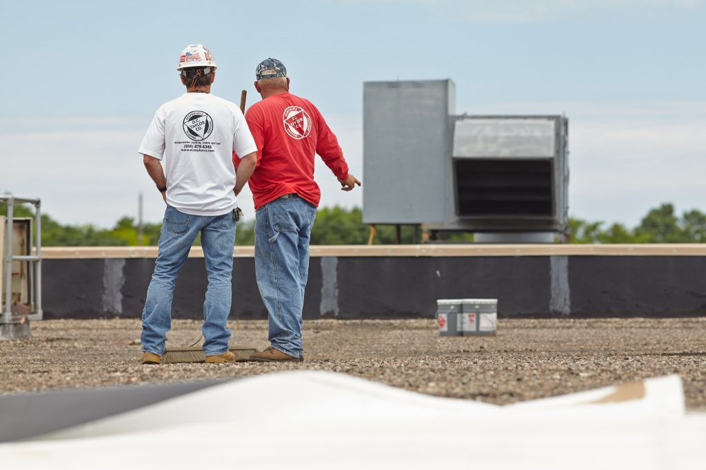 two d. c. taylor co employees having a discussion on a rooftop