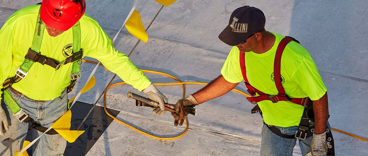 Roofing contractors practicing good safety habits - D. C. Taylor Co.