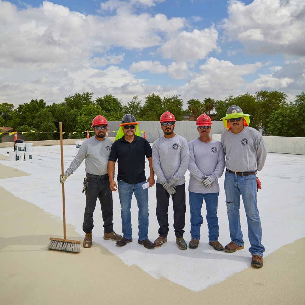 five dc taylor co employees smiling for a picture on a flat roof
